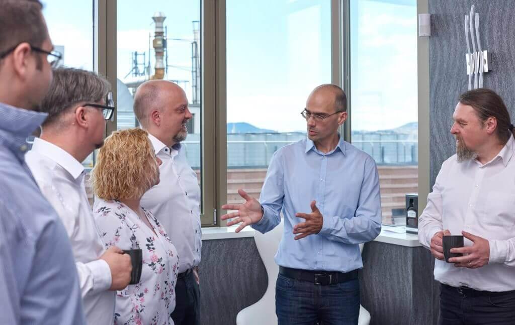 Senior agile consultants discuss transformation strategy