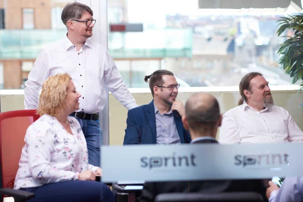 Funny side of a Scrum meeting, consultants laughing