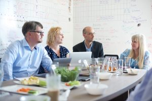 Agile consultants meet at the office of Sprint Consulting