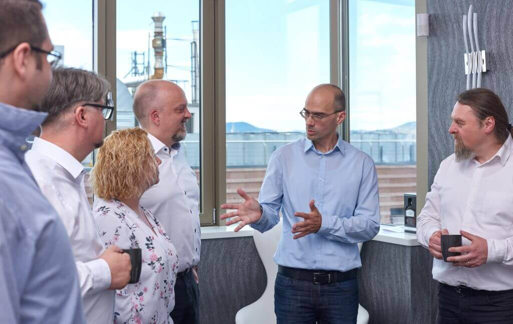 Senior agile consultants discuss transformation strategy
